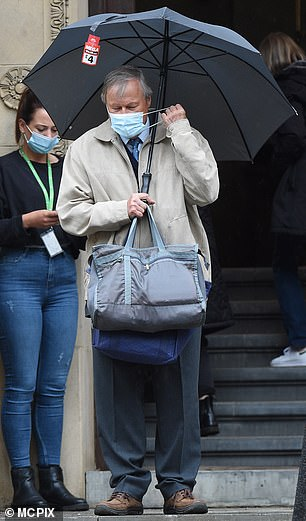 Sticking to the rules: David Neilson was photographed making sure that his mask was on between takes