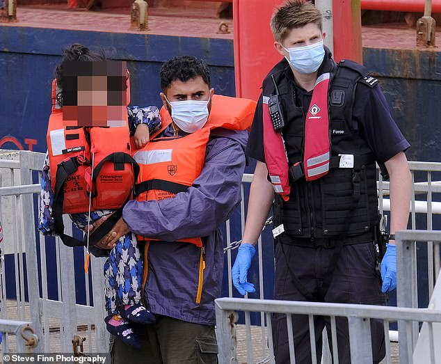 Migrants, including children and toddlers, were arrived to Dover Marina in Kent today after crossing the English Channel