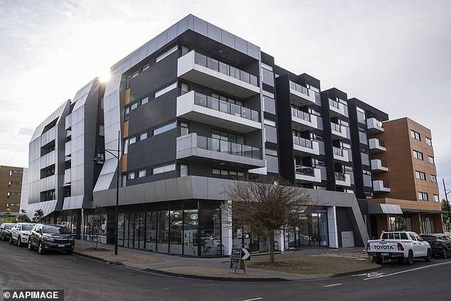 Residents in the Ariele Apartments in Maribyrnong (pictured on Tuesday) cannot leave the building for two weeks after it was visited by infected removalists last week