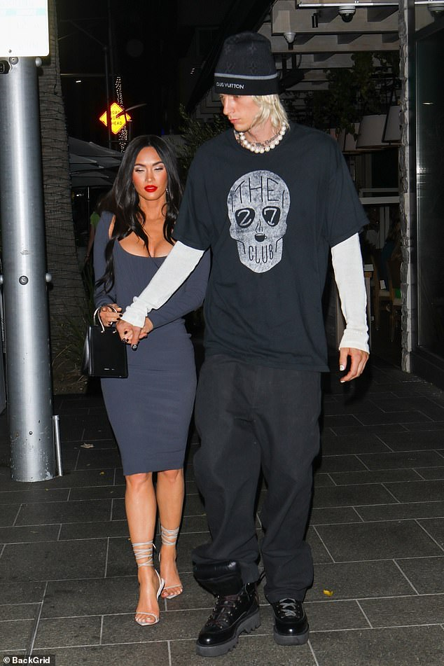 Date night: While strutting out of the restaurant, the lovebirds looked blissfully happy as they held hands and walked closely together back to their car