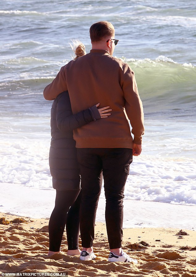 Moment of reflection: The couple took a moment to admire the view while standing arm-in-arm