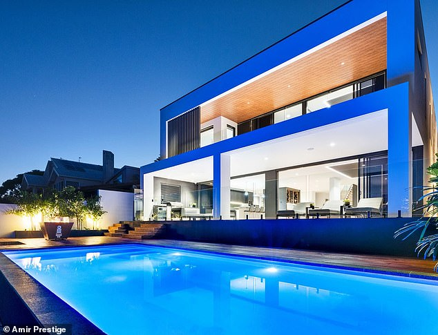 A driver's dream:Renowned Supercar driver Russell Ingall has sold his stunning Gold Coast mansion for what is believed to be close to its asking price of $6.9million