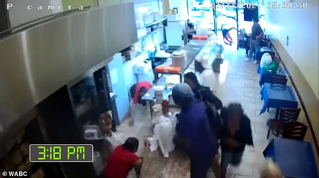 The image above shows surveillance footage from inside the cafe on Sunday