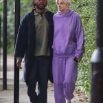 The Crown star Emma Corrin steps out in a purple tracksuit as she holds hands with a mystery man 💥👩💥