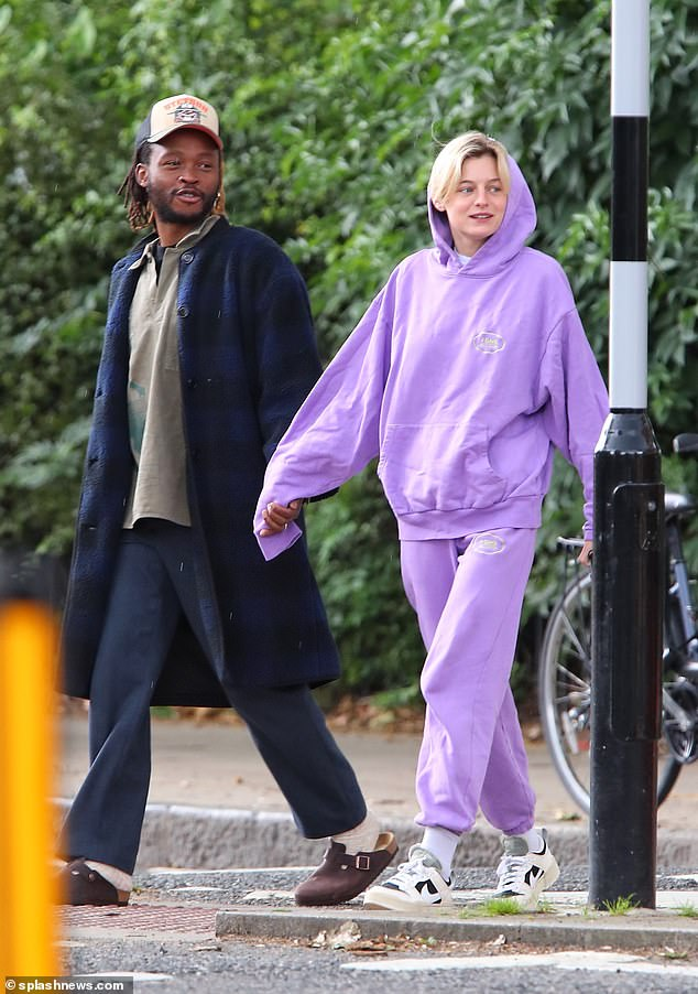 Close: The Crown starlet, 25, was hard to miss in an oversized lilac tracksuit, wearing the hood up over her blonde mane