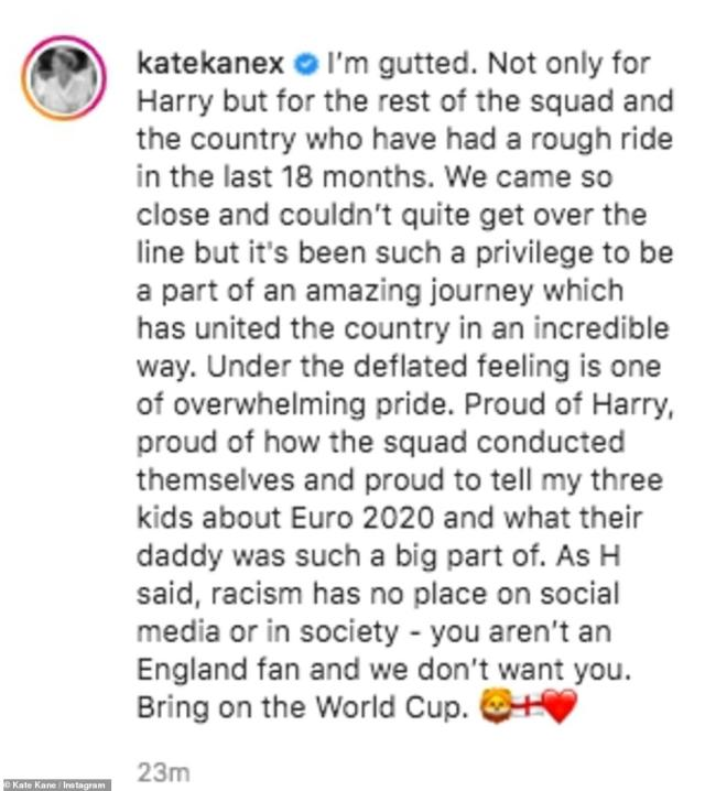 Cute: Harry Kane's wife Kate shared a sweet picture of their two daughters in matching England kits standing underneath 'Welcome home Daddy we love you' balloons and red and white streamers