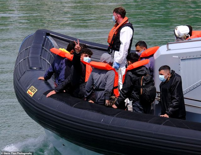 A group of migrants arrive to the Kent coast after crossing the world's busiest shipping route