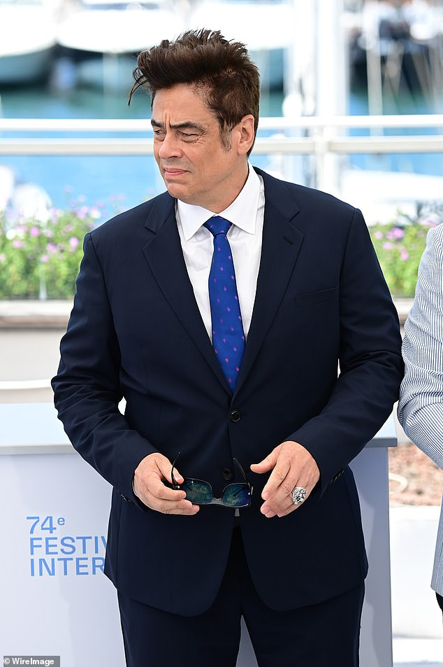 Star: Benicio sported a black suit which he paired with a white shirt and a blue tie