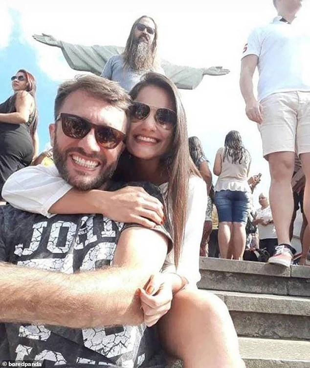 Good god! As a couple posed in front of Christ the Redeemer in Rio, Brazil, a man behind them stood perfectly still and appeared to be a human version of the Jesus statue
