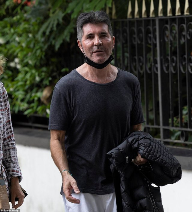 Asked whether he had escaped the flooding, Simon Cowell admitted today 'not really, my house nearly floated away'
