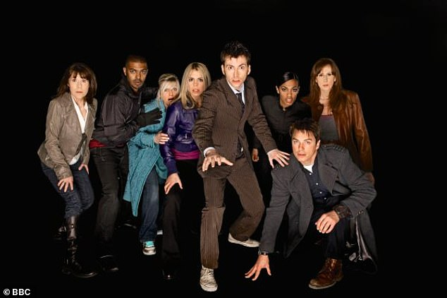 John said his actions were designed to defuse any awkwardness before nude scenes. Pictured: A 2008 Doctor Who cast picture with John as Jack Harkness, front right, and Noel Clarke as Mickey Smith, second left, as well as David Tennant, Catherine Tate and Billie Piper