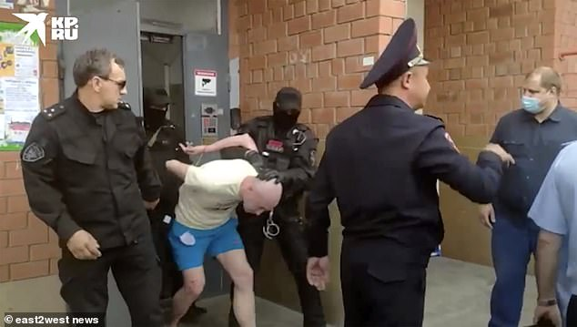 Soon afterwards Russian SOBR national guard special forces stormed the flat and detained the Terentyev. He was seen in handcuffs being pushed into a detention vehicle