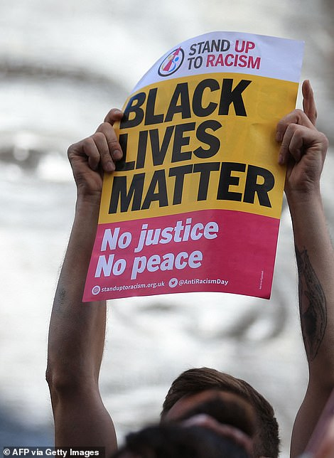 Fans also held up signs saying Black Lives Matter and No Justice No Peace