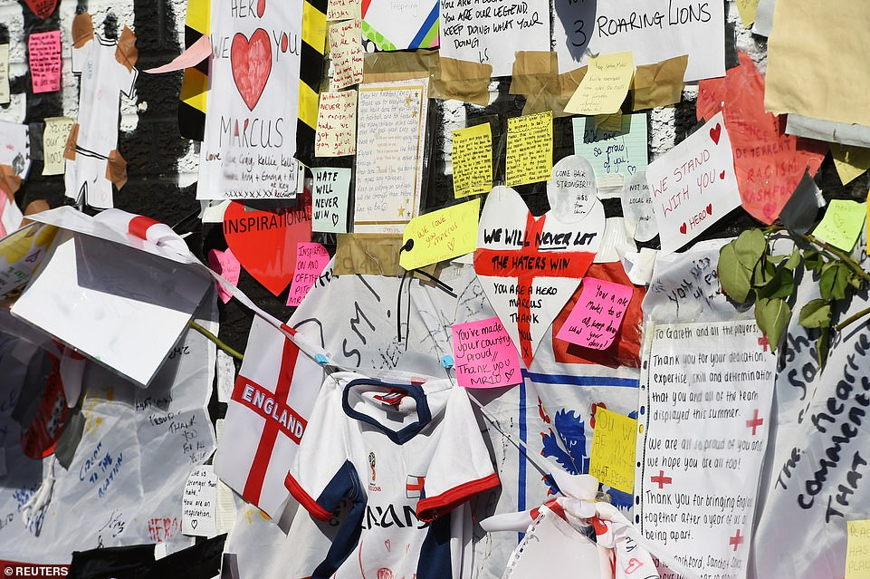 People have left written notes, messages on paper love hearts and England flags and tops on the mural in support of Rashford, who was racially abused online in the aftermath of England's defeat