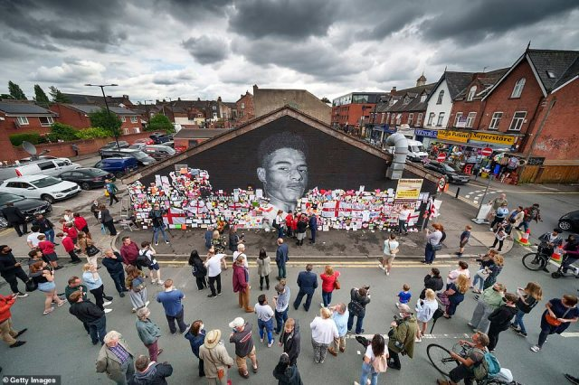 Earlier, crowds of football fans gathered at the mural of Marcus Rashford which was repainted earlier today after being daubed with 'racist' graffiti in the wake of his Euro 2020 penalty heartache