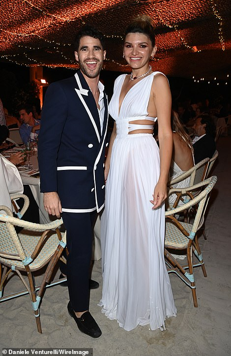 Glamorous: Glee star and singer Darren Criss donned a navy blue suit with white buttons