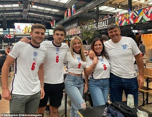 Maguire's family including Alan (right) pose for a photograph earlier in the tournament