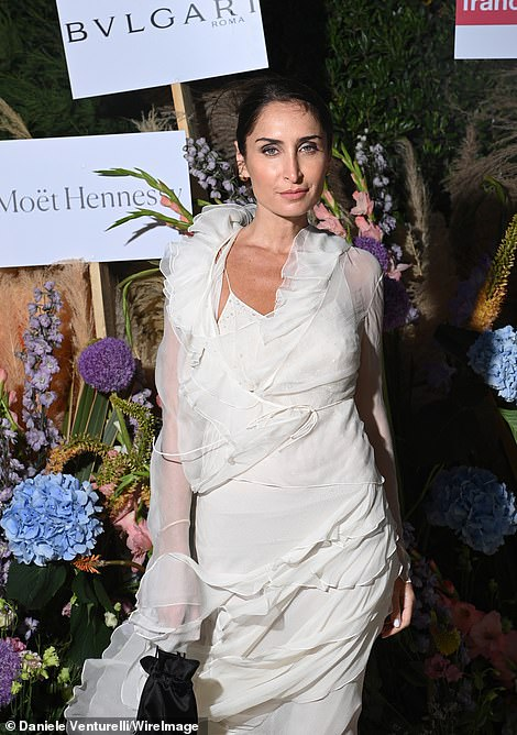 Showing her skills: Fashion consultant and stylist Geraldine Boublil proved she knows a thing or two about glamour as she arrived at the charity dinner wearing a cream gown covered in lace and sheer layered detailing