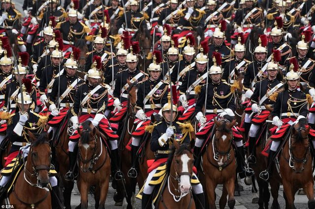 The traditional parade on France's national day returned to the Champs-Elysees after a one-year hiatus caused by the Covid-19 pandemic. Pictured: Republican Guard ride their horses during the Bastille Day parade