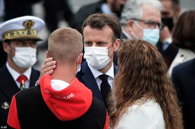 French President Emmanuel Macron meets with families of French soldiers at the end of the annual Bastille Day parade