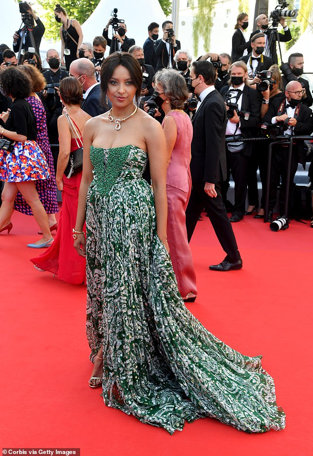 Vision in green: Kat commanded attention last Tuesday as she arrived at Cannes Film Festival in a billowing strapless gown