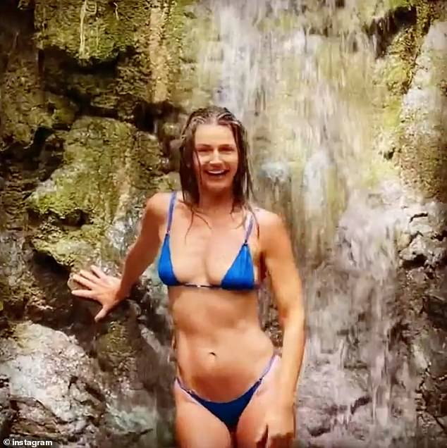 Keeping it real: Paulina admitted in the caption that they 'got totally lost' after she filmed the clip, which shows her leaning against a rock as the waterfall pours down on her