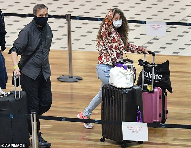 Victoria, South Australia and Western Australia have already closed their borders to NSW. Pictured: People at Brisbane Airport