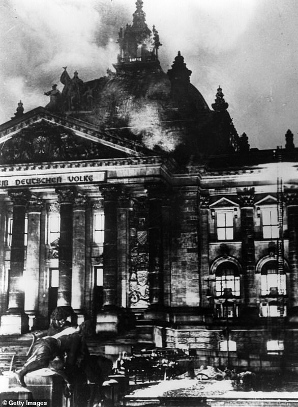 The February 27, 1933 file photo above shows the Reichstag building, Germany's parliament, on fire. It is considered a key turning point in the Nazi rise to power