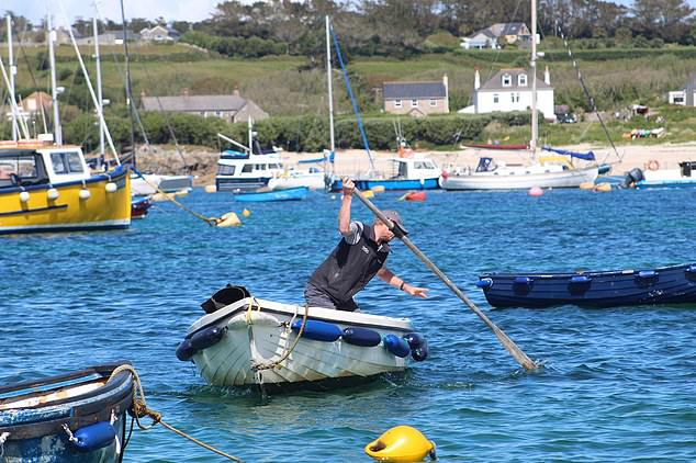 This is the shocking moment a furious boatman on the Isles of Scilly allegedly used an oar to bash Wally the Walrus in front of horrified holidaymakers