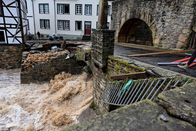 The Erft river is seen flowing underneath a damaged bridge in the town ofBad Muenstereifel, Germany