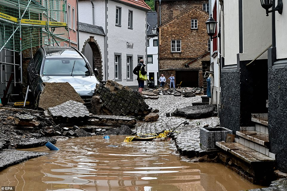 A damaged road after flooding in the town of Bad Muenstereifel after the Erft river broke its banks