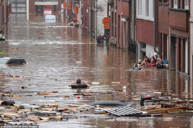 BELGIUM: People evacuate their flooded homes in the city ofLiege, Belgium, after torrential rains left their street underwater