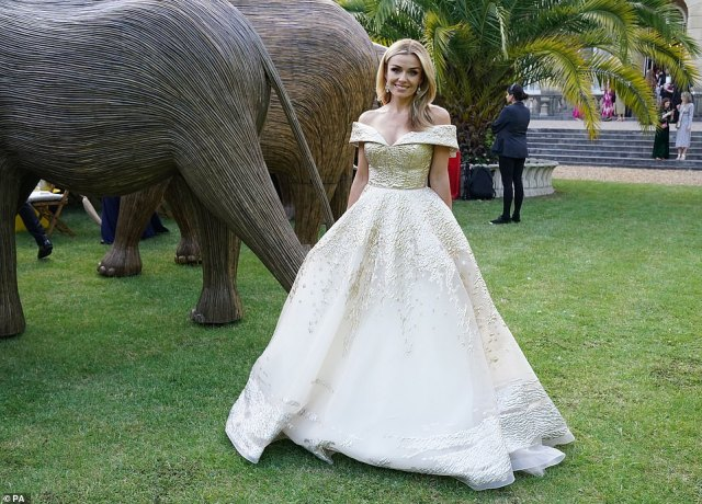 Katherine Jenkins poses in front of some of the elephant sculptures, created by indigenous communities in the jungles of Tamil Nadil, which are being auctioned