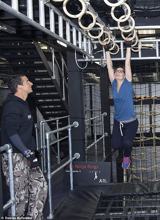 London's High Court heard Ms Harrison was a fitness enthusiast before her accident, entering the Bear Grylls challenge alongside other members of her local gym. Pictured: Mr Grylls coaches a woman through the monkey rings on an assault course