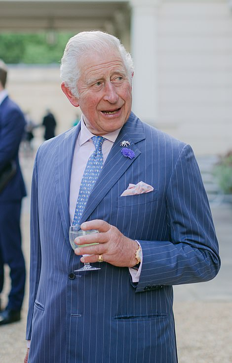 The prince, dressed in a smart pinstripe blue suit with a silver elephant pin, appeared in high spirits yesterday evening as he spoke to guests