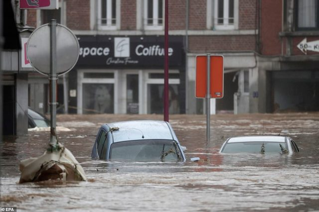 Cars in the water as flooding affects the area after heavy rains in Ensival, Belgium