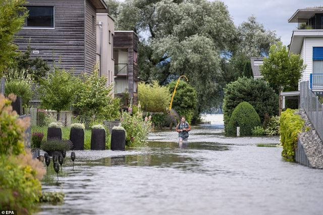 The Ried neighbourhood on Lake Sarnen in the canton of Obwalden is covered with flood water, in Giswil, Switzerland