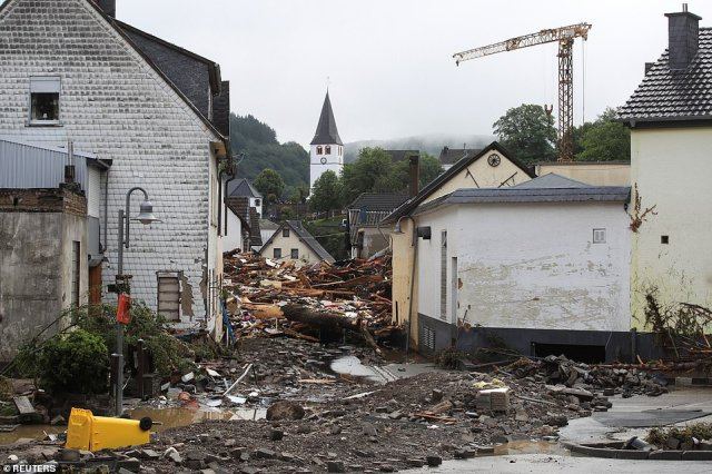 Collapsed buildings are seen on a flood-affected area following heavy rainfalls in Schuld, Germany