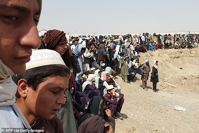 Pakistan border guards used tear gas to disperse hundreds of people gathered on the Afghan border waiting to cross