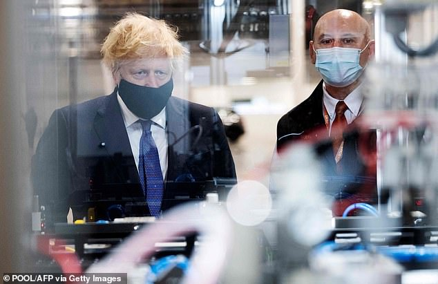 Boris Johnson (pictured in Coventry today) has insisted the government is committed to the 'triple lock' pledge from the 2019 Tory manifesto