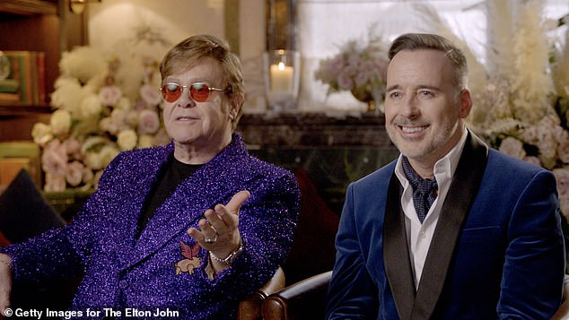 Sir Elton John and his husband David Furnish, pictured in April, who is working with Meghan