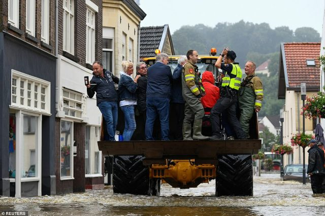 People are evacuated from a flood-affected area, following heavy rainfalls in Valkenburg, Netherlands