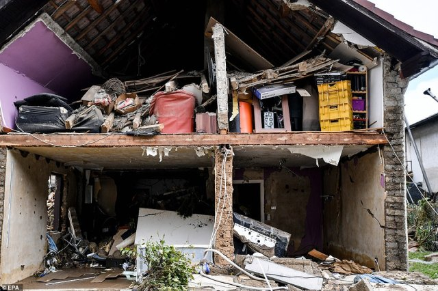 The back end of a house was torn away leaving the interior rooms exposed during flooding in Schuld, Germany
