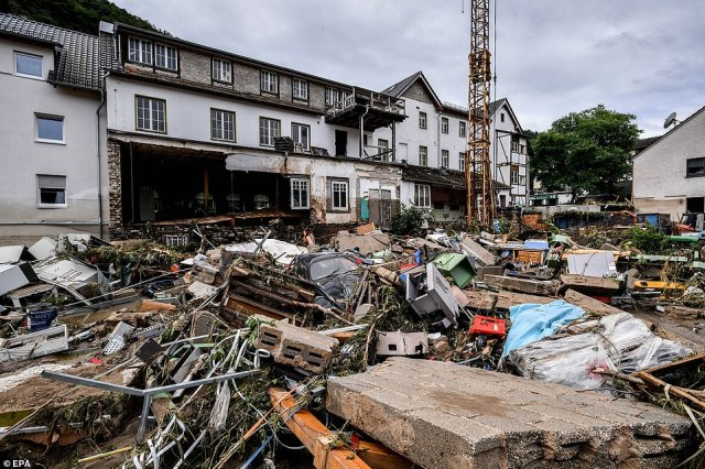 GERMANY: A pile of debris including a battered car is seen in the middle of the street in Schuld after it was hit by floods