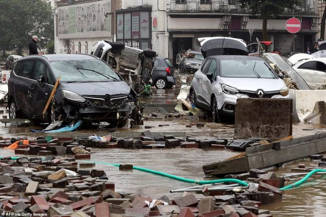 Damaged cars on a flooded street in the Belgian city of Verviers, after heavy rains and floods lashed western Europe