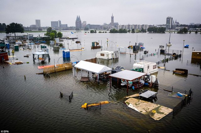Caravans and campers under water at the De Hatenboer campsite in Roermond, Netherlands