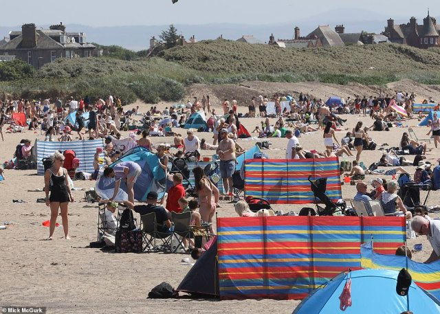 People flock to Troon Beach in Ayrshire on one of the hottest days of the year so far