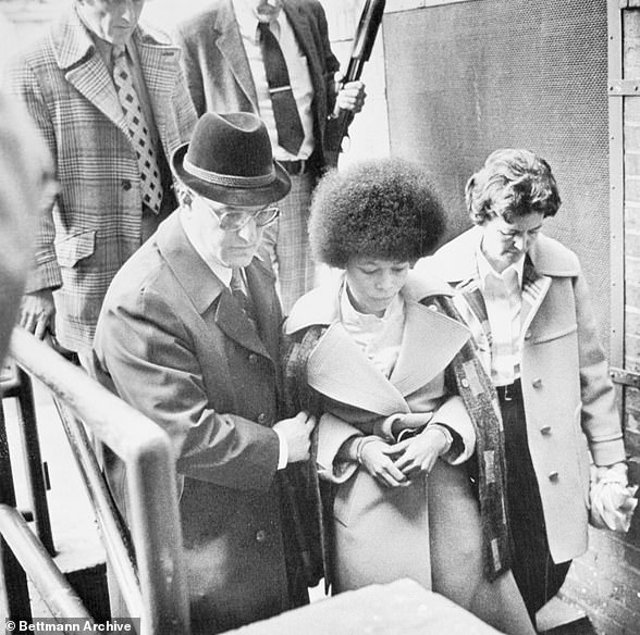 Back militant leader Joanna Chesimard leaves Middlesex County court after being sentenced to 26 to 33 years on various assault, weapons and robbery charges in connection with the 1973 murder of a New Jersey State trooper