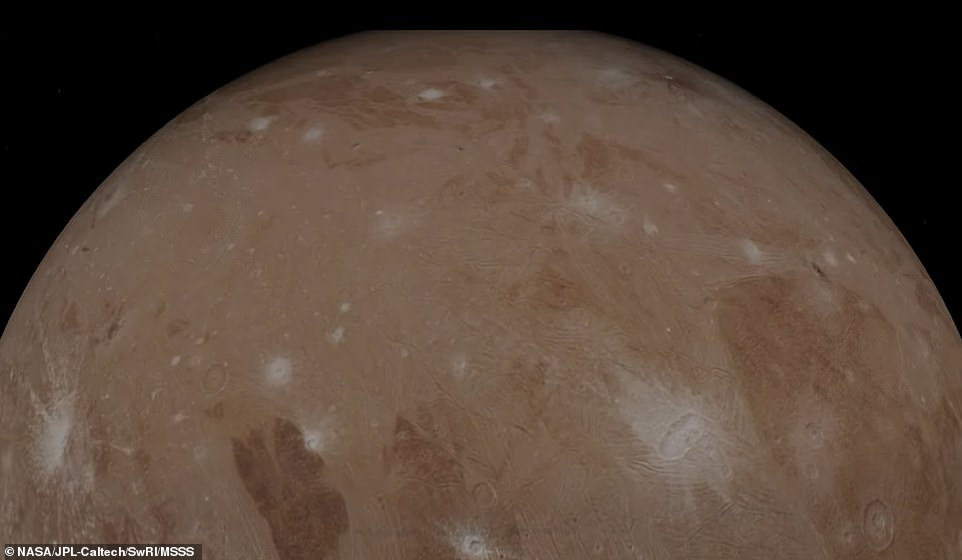 NASA has released a 'starship captain' point of view of Jupiter and its moon, Ganymede (pictured), in a series of images captured by the Juno probe before and after making its 34th flyby of the gas giant.