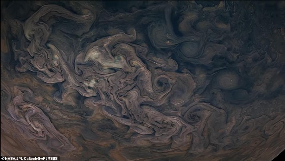 At this point of view, Juno's JunoCam captures the stunning cyclones (pictured) swirling around the north pole